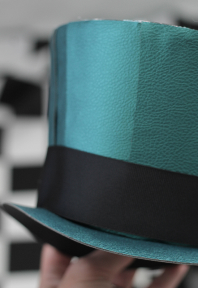 Closeup mad hatter hat_peacock pebbled leather