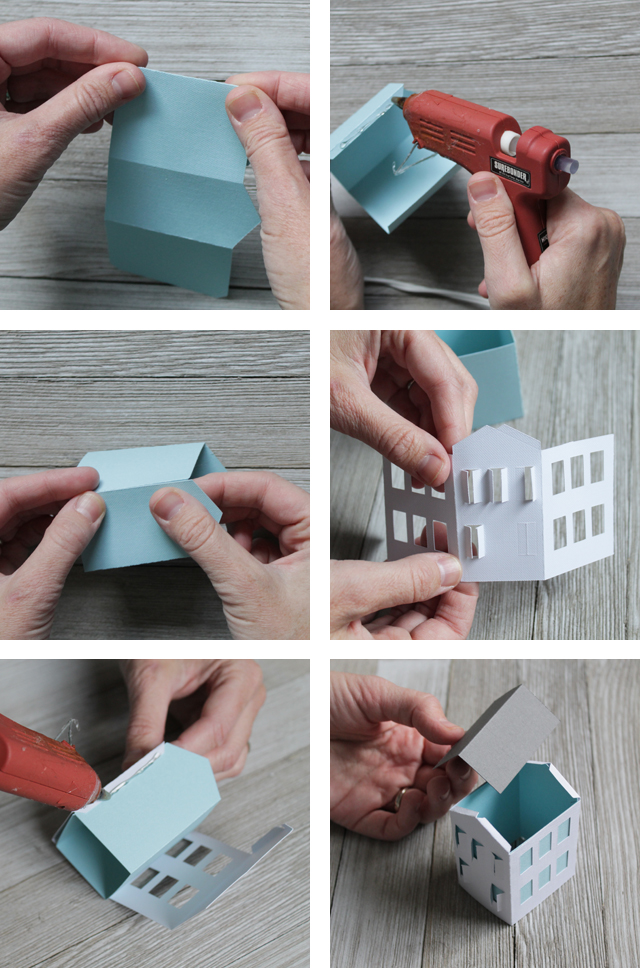 Assembling a paper Christmas Village House